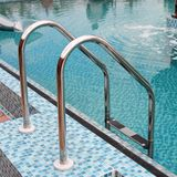 Brilliant hand-rail leaders in pool. On open air Royalty Free Stock Photo