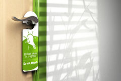 Brilliant ideas. Green door hanger onto a handler with room for text on the wall at the right side. On the sign it's written brilliant ideas in progress, do not Royalty Free Stock Photography
