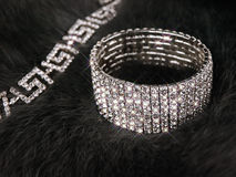 Brilliant jewellery at fur Royalty Free Stock Photography