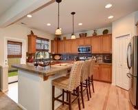 Brilliant kitchen with simplistic decor. Brilliant kitchen with great lighting and simplistic decor Royalty Free Stock Photos