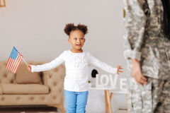 Brilliant loving daughter making a surprise for her mom. Listen this. Excited talented little child telling her mother a poem about her love while meeting her at royalty free stock photos