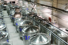Brilliant metal cisterns lined up in long rows. Stock Photos