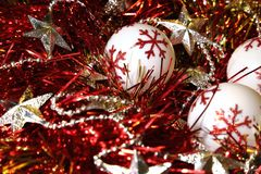 Brilliant New Year and Christmas decorations balls, tinsel and stars. Royalty Free Stock Image