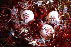 Brilliant New Year and Christmas decorations balls, tinsel and stars. Stock Photos