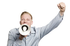 Enthusiastic businessman shouting with megaphone. Royalty Free Stock Photography