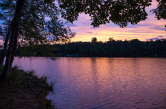 Brilliant Northwoods Sunset. Brilliant sunset over a wilderness lake Stock Photos