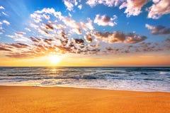 Brilliant ocean beach sunrise. Stock Images