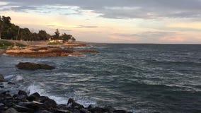 Brilliant ocean beach sunrise stock video footage