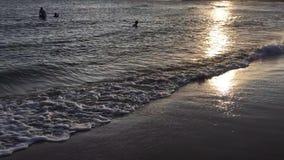 Brilliant ocean beach sunrise stock video
