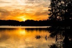 Brilliant Orange Sun at Dusk at Stumpy Lake. In Virginia Beach, Virginia Stock Photos