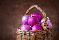 Brilliant Pink Christmas Balls in a Basket Royalty Free Stock Photography