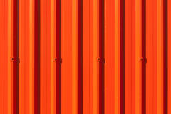 Brilliant red corrugated painted metal wall background. Stock Photo
