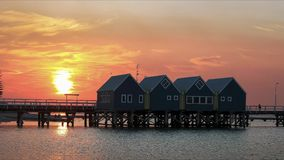 A brilliant red sunset at west australia`s busselton jetty. The longest jetty in the southern hemisphere stock images