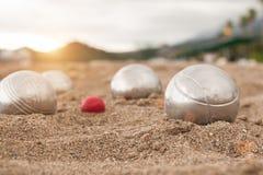 Brilliant silver balls for a bocha on the sand. stock image