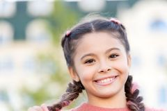 Brilliant smile. Sincere emotional kid. Girl emotional face. Childhood and happiness concept. Kid happy beautiful face royalty free stock images
