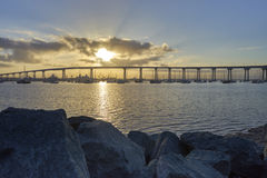 Brilliant sun coming up over the Coronado Bridge, San Diego California Royalty Free Stock Images