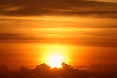 Brilliant sunrise. A brilliant, glorious sunrise breaking forth from the clouds Stock Image