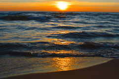 Brilliant sunrise over the waters of Lake Huron. Sunrise over the waters of Lake Huron in Oscoda Michigan at the Oscoda Beach Pier Stock Photos
