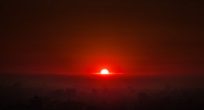 Brilliant Sunrise. A brilliant red sunrise over a city Royalty Free Stock Photo