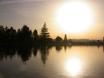 Brilliant Sunset. Sun setting over Mt Tabor Water Reservoir in Portland, OR Stock Photo