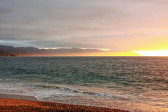 Brilliant sunset over the ocean and mountains, Bay of Banderas Mexico Stock Photography