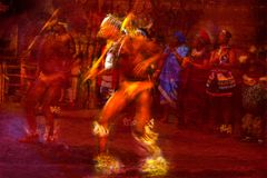 Brilliantly colored African Dancers in motion against a red textured background. Brilliantly colored African Dancers in motion against a passionate red textured Stock Photos