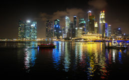 Brilliantly Lit Singapore Skyline from the Harbor at Night Stock Images