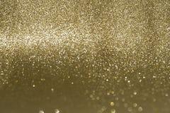 Brillo brillante, efecto de oro del bokeh del fondo imagenes de archivo