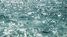 Brillo de Sun en superficie del mar Riegue el fondo superficial