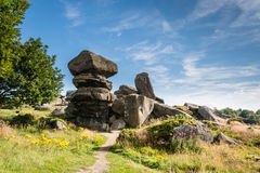 Brimham Rocks. On Brimham Moor in North Yorkshire are weathered sandstone, known as Millstone Grit,creating some dramatic shapes, many of which have been named Stock Image