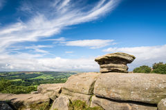 Brimham Rocks view over Nidderdale Valley. Brimham Rocks on Brimham Moor in North Yorkshire are weathered sandstone, known as Millstone Grit,creating some Royalty Free Stock Photo
