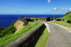 Brimstone Hill Fortress entrance gate and road in a bright sunny day with sea on the background Royalty Free Stock Photos