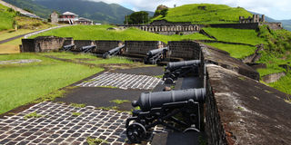 Brimstone Hill Fortress - Saint Kitts. Cannons line the walls at Brimstone Hill Fortress National Park on Saint Kitts Royalty Free Stock Photos