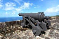 Brimstone Hill Fortress - St Kitts. A cannon faces the Caribbean Sea at Brimstone Hill Fortress National Park in St Kitts stock photo