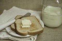 Brinde amanteigado com leite Foto de Stock Royalty Free