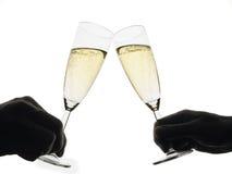 Brinde com flautas de champanhe Fotografia de Stock Royalty Free