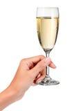 Brinde do vidro do champanhe da mão Imagens de Stock Royalty Free