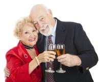 Brinde dos séniores com Champagne Foto de Stock Royalty Free