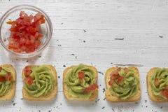 Brinde, guacamole e tomate Imagens de Stock Royalty Free