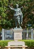 Cesare Augusto Imperatore statue. Brindisi, Italy. Brindisi, Italy - August 12, 2017. Cesare Augusto Imperatore statue in Piazza del Popolo square in background Royalty Free Stock Photo
