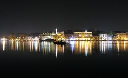 Brindisi by night. Sight of Brindisi from the harbour in the night royalty free stock images