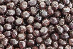 Brine cured Grade A Mediterranean black olives Stock Image