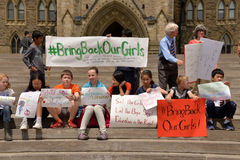 Bring back our girls rally in Ottawa. School childern gather for a rally to activate governments to rescue the girls in Nigeria and protect school girls across Royalty Free Stock Photography