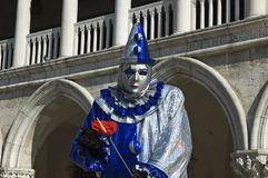 Bring in the Clowns. A clown dressed in silver and purple,poses in Saint Marks Square,Venice,Italy,in preperation for Carnivale,the mardi gras of Europe Stock Images