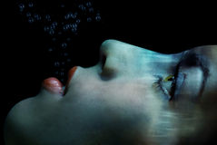 Bring me to life. The last breath of the drowned woman under the water Royalty Free Stock Photos