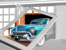 Bring your dream car to life!. Conceptual photo of bringing your dream car to life showing garage scene with tablet view in colour Stock Photography