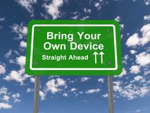 Bring your own device sign. Green bring your own device straight ahead road sign with blue sky and cloudscape background Royalty Free Stock Photography