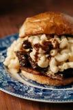 BringaMac och ostsmörgås Arkivfoto