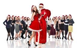 Bringen Sie Frost und Frau in rotem Weihnachtskleid hervor Stockfotos