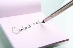 Bringen Sie uns Schreiben in Kontakt Stockbilder